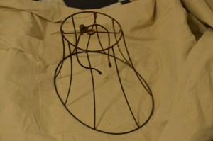 Rusty old lamp shade frame.