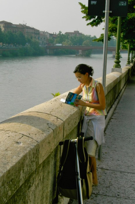 Checking the guidebook in Verona