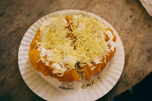Langos with sour cream and cheese