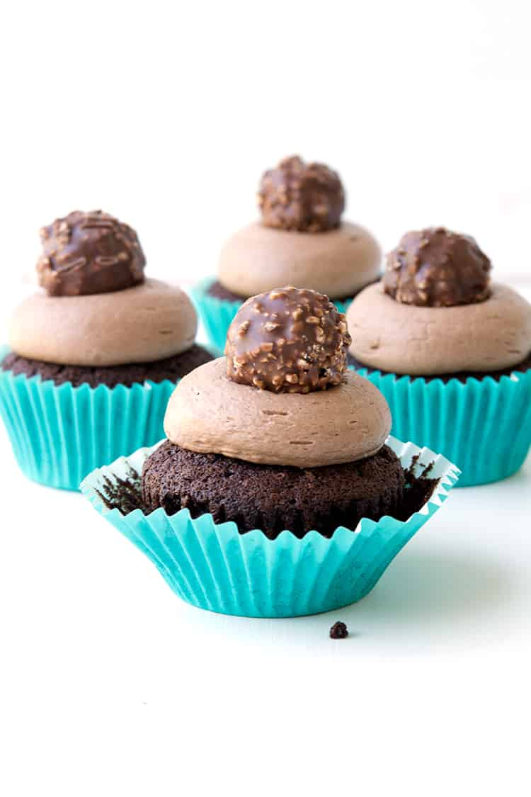 Nutella Stuffed Chocolate Cupcakes | via sweetestmenu.com