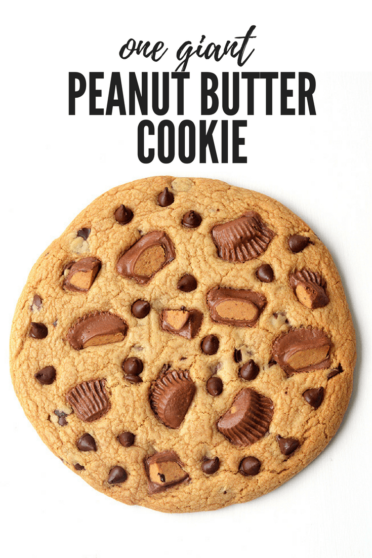 One BIG Peanut Butter Cookie! This gorgeous buttery cookie is stuffed with chocolate chips and Reese's peanut cups! Recipe from sweetestmenu.com #cookie #peanutbutter #chocolate #cookies