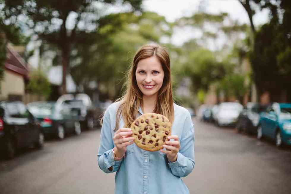 Jessica Holmes holding a giant cookie