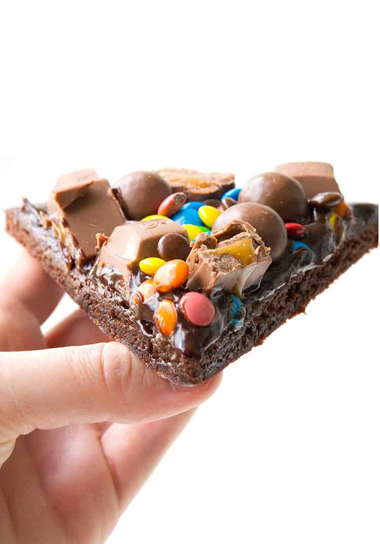 A slice of M&M Chocolate Brownie Pizza