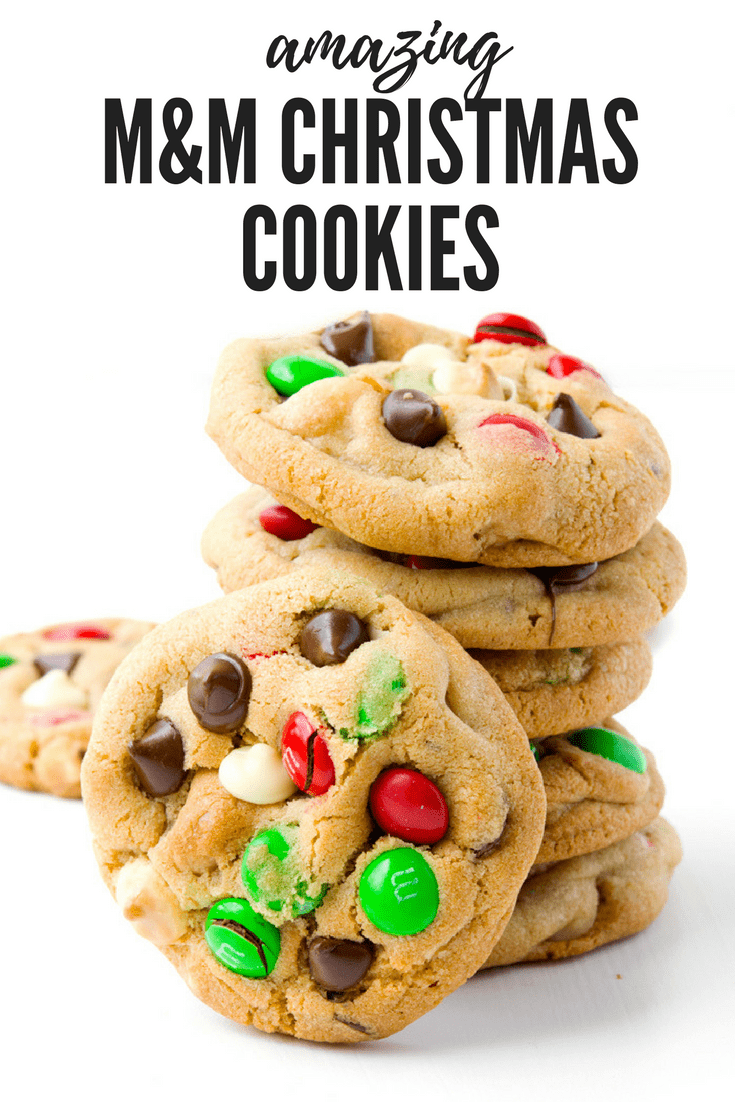 Soft and chewy cookies stuffed with M&M's, white chocolate chips, milk chocolate chips and roasted macadamias! These cookies are perfect for Christmas! Recipe from sweetestmenu.com #cookies #candy #Christmas #chocolatechip #macadamias