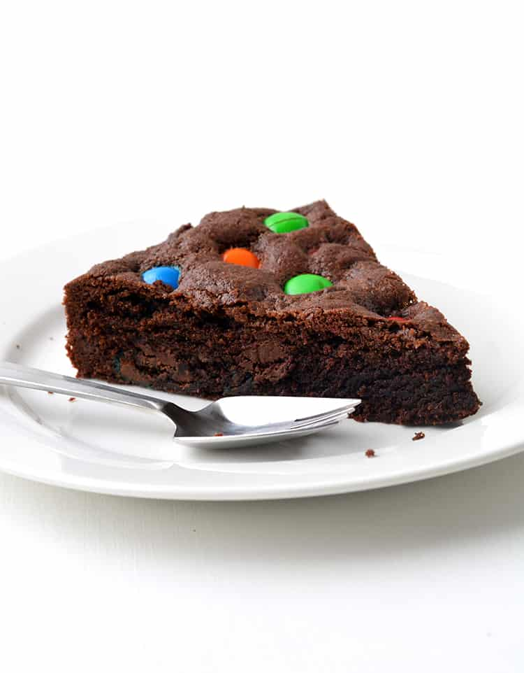 A slice of M&M Chocolate Cookie Cake