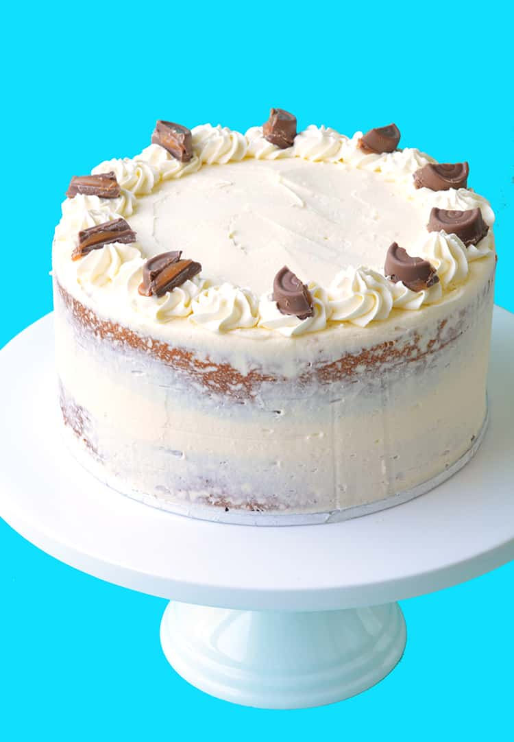 A beautiful two layer Caramel Mud Cake on white cake stand