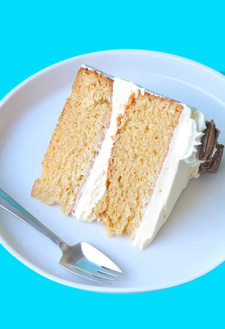 A slice of Caramel Mud Cake on a white plate