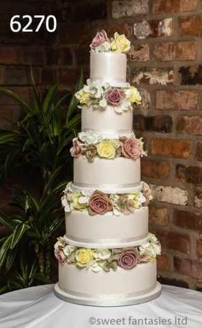 5 tier round wedding cake with fresh & silk flowers