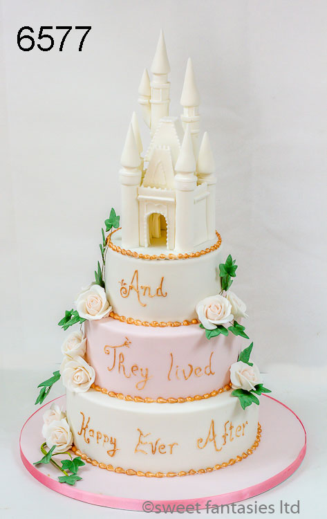 pink & white wedding cake with castle