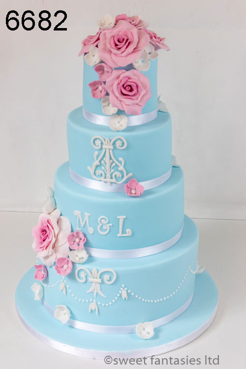 pale blue wedding cake with pink roses