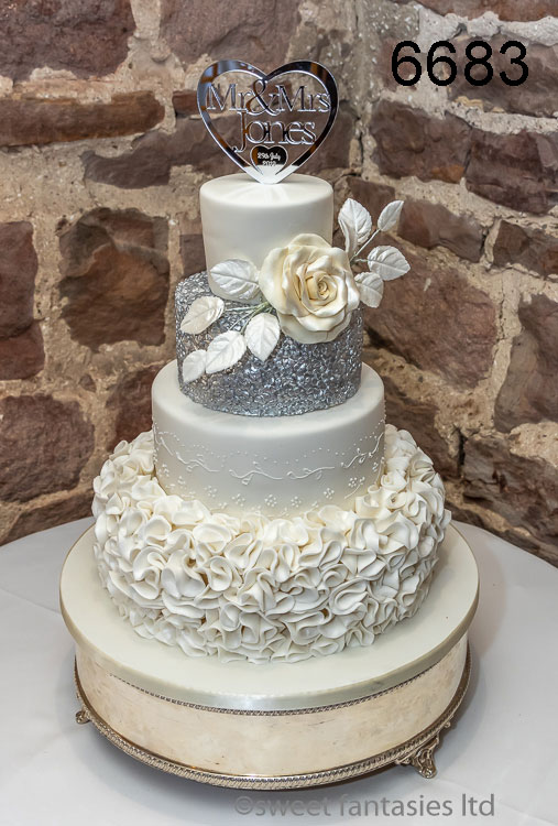 4 tier white & silver wedding cake with rose