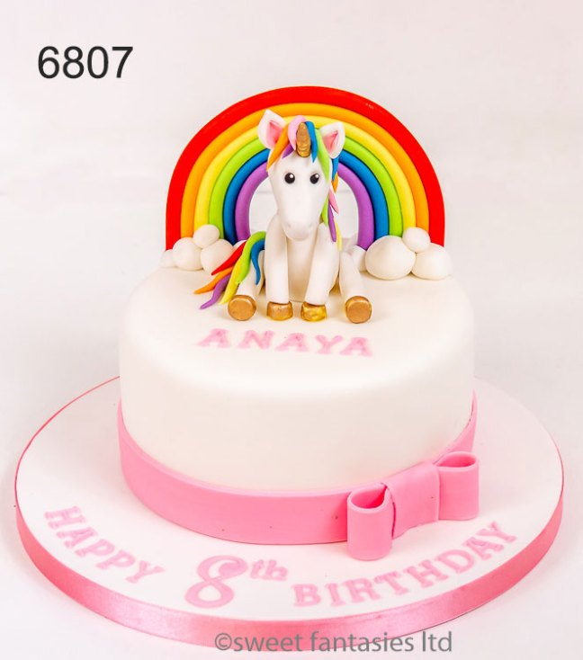 Unicorn with rainbow ,pink & white girls birthday cake.
