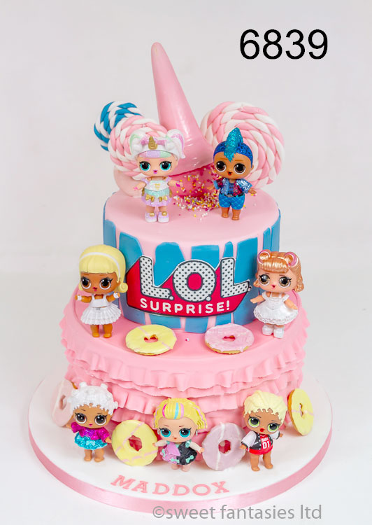 2 tier LOL surprise cake with LOL dolls