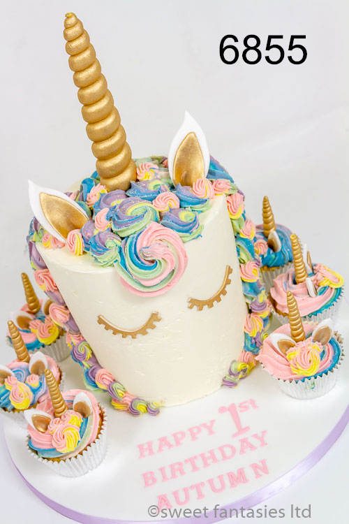 Unicorn cake with rainbow buttercream & cupcakes