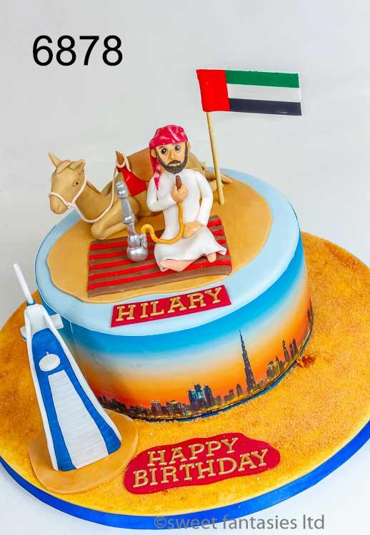 Dubai themed birthday cake with arab man, camel & Burj Khalifa