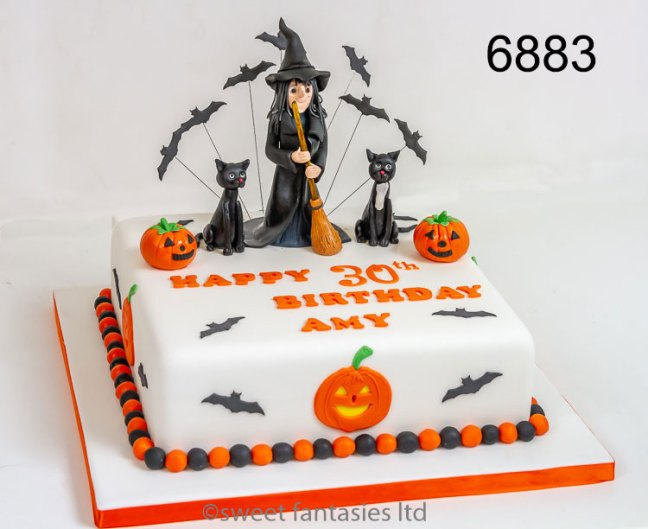 halloween themed birthday cake, with witch & cats
