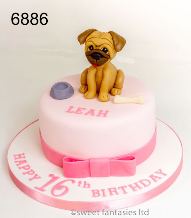 Pale pink cake with a model of a pug dog on top