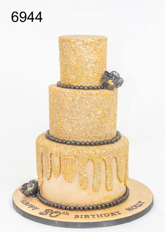 3 tier gold glitter with black trim & flowers. birthday cake