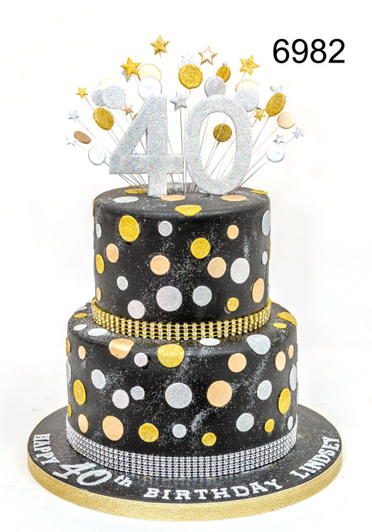 2 tier black 40th birthday cake with gold & silver spots