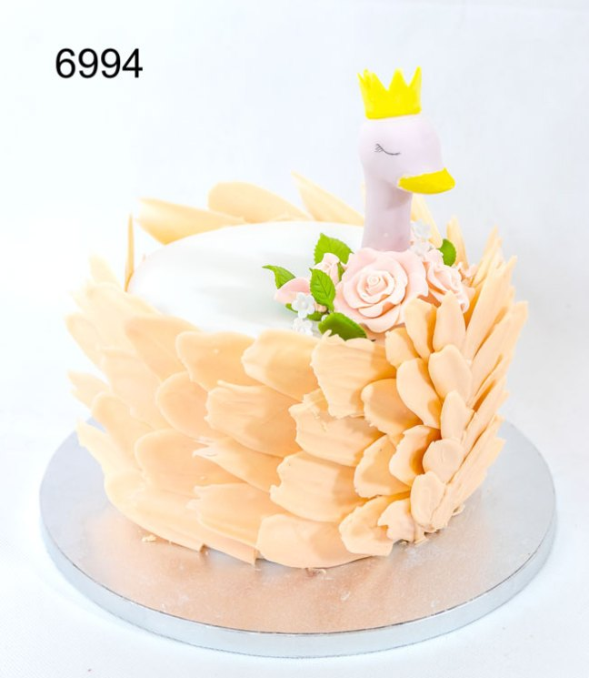 6994 - single tier girls birthday cake. Swans neck & headon top,with feathers around the sides of the cake