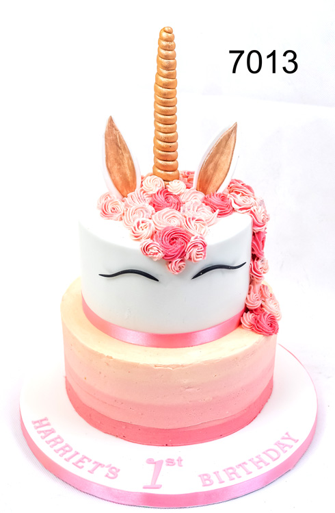 7013 - 2 tier unicorn cake, bottom tier pink ombre colours, top tier unicorn with multi coloured buttercream main