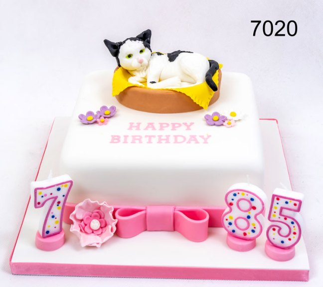 7th & 85th white & pink cake with a cat in a basket