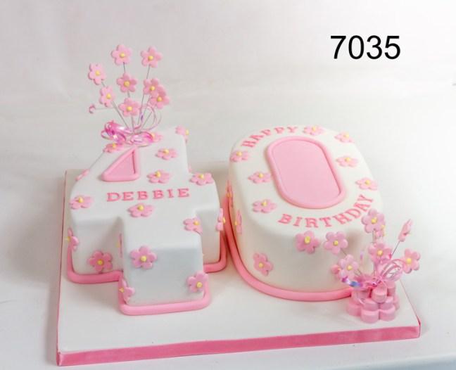 Pink & white Number (figure) 40 birthday cake