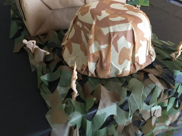 Army Camouflage 60th Birthday Party - cut the camouflage netting into three pieces for the table runner SweetLaneEvents.com