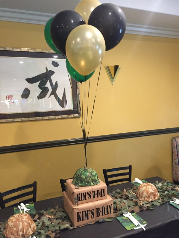 Army Camouflage 60th Birthday Party - Army themed centerpiece with black green & gold balloons SweetLaneEvents.com