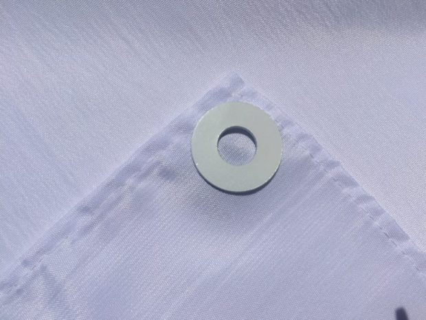 At each corner of the table, place the washer on the front side of the tablecloth - SweetLaneEvents.com