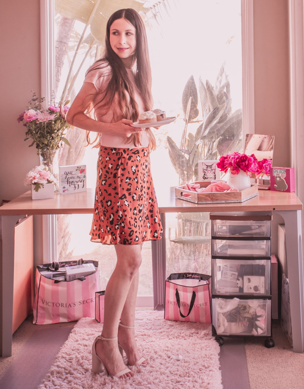 A Pink Top and Animal Print Skirt Outfit