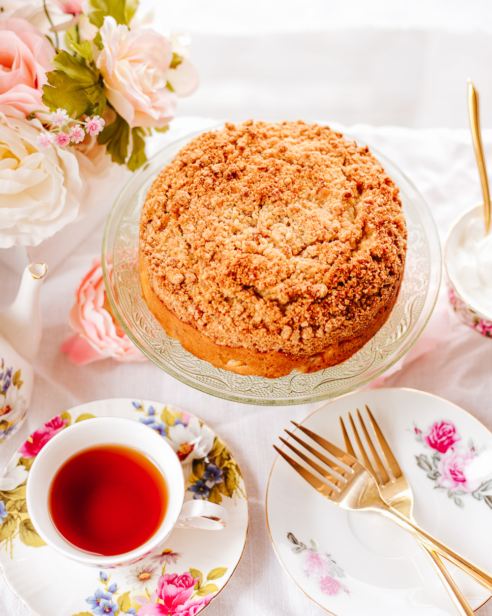 The Healthy Peach Coffee Cake is soft and tender, bursting with the fresh peach flavor and topped with lusciously yummy streusel! It's very easy to make, wholesome and lower calorie than a traditional coffee cake, yet with a few recipe tweaks it doesn't trade in the flavor!