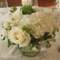 Sweet pea flowers centerpiece in a glass cylinder