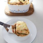 Eggplant and zucchini lasagne - deliciously layered slices of roasted vegetables, a rich tomato sauce, a cheese-y white sauce with a tofu and pine nut top.