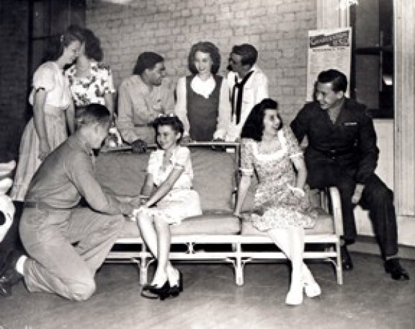 During World War II, many a young person found love in an unlikely place: the Joseph Manigault House. During its stint as a United Service Organizations (USO) dormitory from 1942 to 1946, the antebellum estate, once home to the rice planting Manigault family, shifted gears to house military personnel, volunteers, and the legion of industry workers who flooded the Holy City to aid in wartime efforts. Providing familiar comforts and entertainment to keep spirits high on the homefront, the house was a home away from home for some 345,000 visitors during its four-year run. The USO building also took on the role of meeting place for young men and women as it hosted festivities for its residents and the surrounding community—activities such as archery and athletics took place daily, as well as countless formal teas and dances, such as this Valentine's Day affair in 1942, during which many fabled love stories might have begun.
