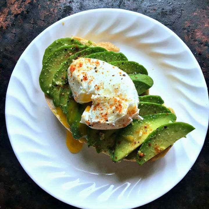 Avocado toast with lemon zest, spiced with smoked paprika, and topped with a creamy poached egg won't stop you from getting a house, promise.