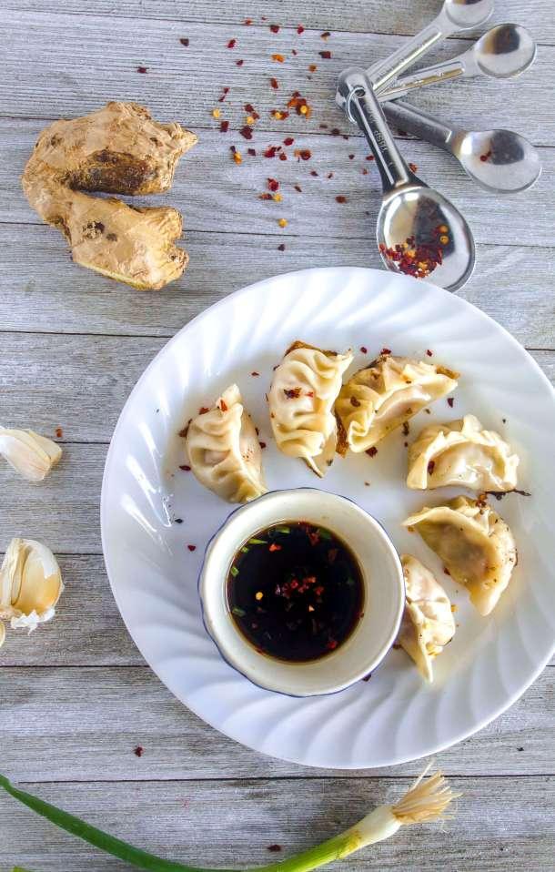 Gyoza, pork dumplings, pot stickers, what ever you call them, they're an Asian take-out staple made easily and deliciously at home, filled with ginger, garlic, and fragrant sesame oil then steamed and fried. Grab a partner, grab some pork, and get to pleating, you'll never need that Chinese take-out menu again.