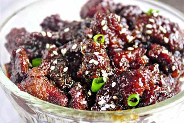 Homemade Mongolian Beef in less than 30 minutes! Crispy slices of steak are tossed in a sauce full of ginger, garlic, and rich flavor. Make this popular Chinese take out beef recipe with a sticky, sweet-savory sauce for your weeknight dinner.
