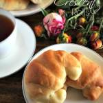 Rich, buttery crescent rolls are super easy, and don't require any elbow grease or a stand mixer to knead! An easy and simple bread recipe that is the perfect dinner roll any day.