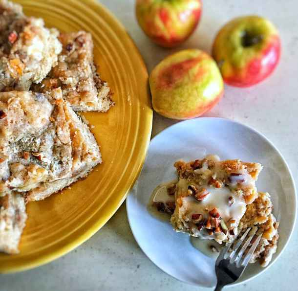 Apple coffee cake is the ultimate fall dish. Moist, tender cake with diced apples folded in, a brown sugar-pecan swirl throughout, and an amazing cinnamon-sugar streusel on top. Oh, and don't forget that maple-vanilla glaze.