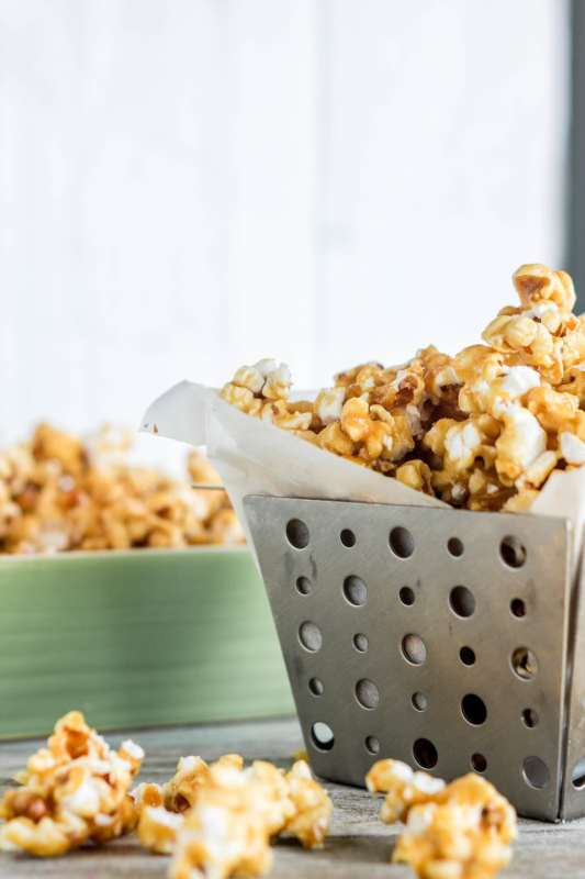 Caramel corn is sweet, crunchy, and super easy to make! The homemade stuff not only tastes better, but is also much more affordableandmakes a ton of it to share.