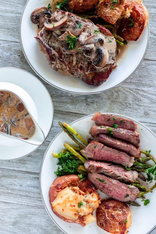 New York strip steak: tender, beefy, basted with garlic butter and served with a mushroom cream pan sauce. The hubby's favorite way to have steak!