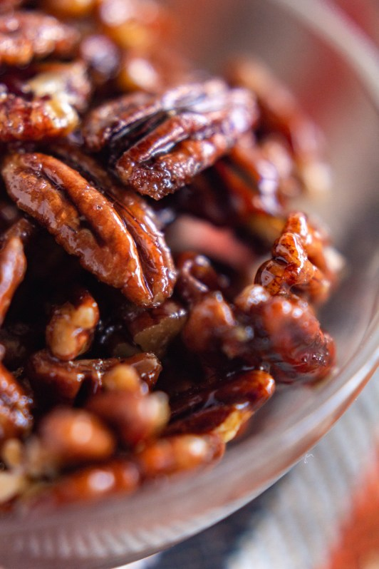 Simple ingredients and a little warm spice in these stove top candied pecans make it a deliciously sweet treat that's easy to quickly pull together for a party, for a snack, or for your salad!