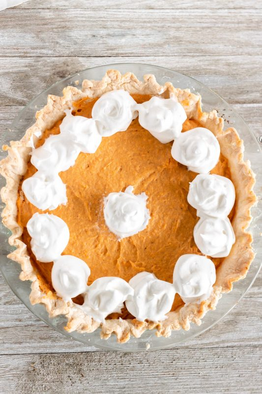 Overhead shot of sweet potato chiffon pie with dollops of whipped cream on Sweet Tea and Thyme | www.sweetteaandthyme.com