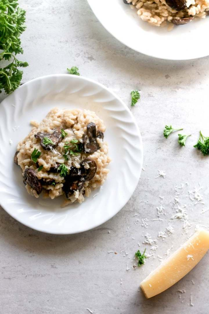 An oh so creamy, cheesy, and wonderfully comforting mushroom risotto recipe. The mushrooms add a rich, earthy flavor that really go with the big pile of fresh parmesan you'll be piling on top.