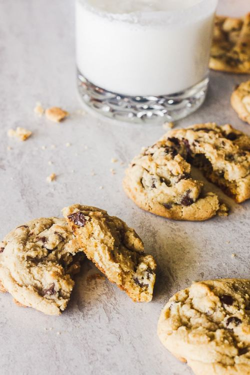 a closer shot of warm chocolate chip cookies with two broken in half