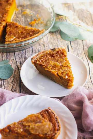 a view of slices of bourbon sweet potato pie being served