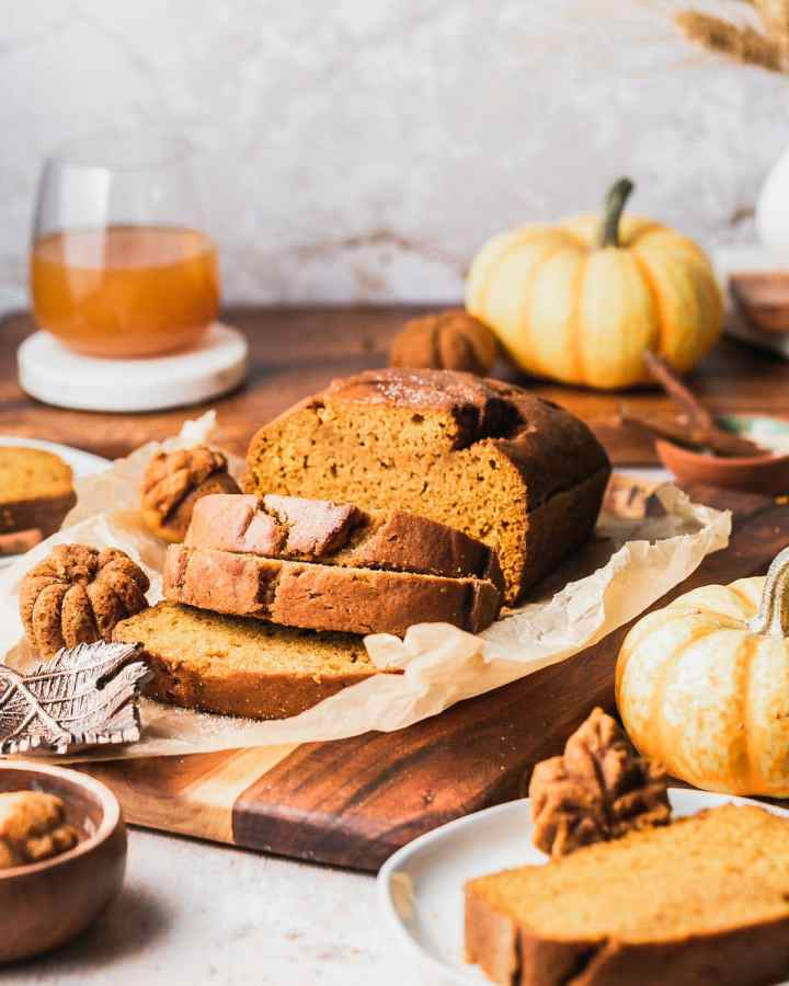 super moist pumpkin bread loaf and cakelets sit on parchment paper