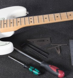 fender strat on workbench next to tools [ 6505 x 2076 Pixel ]