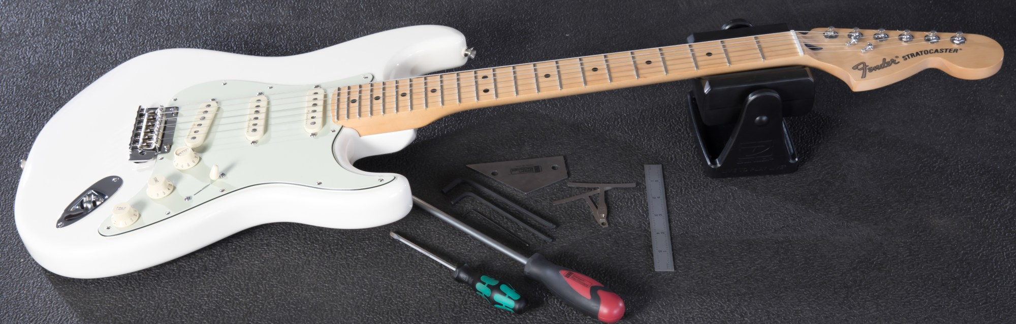 hight resolution of fender strat on workbench next to tools